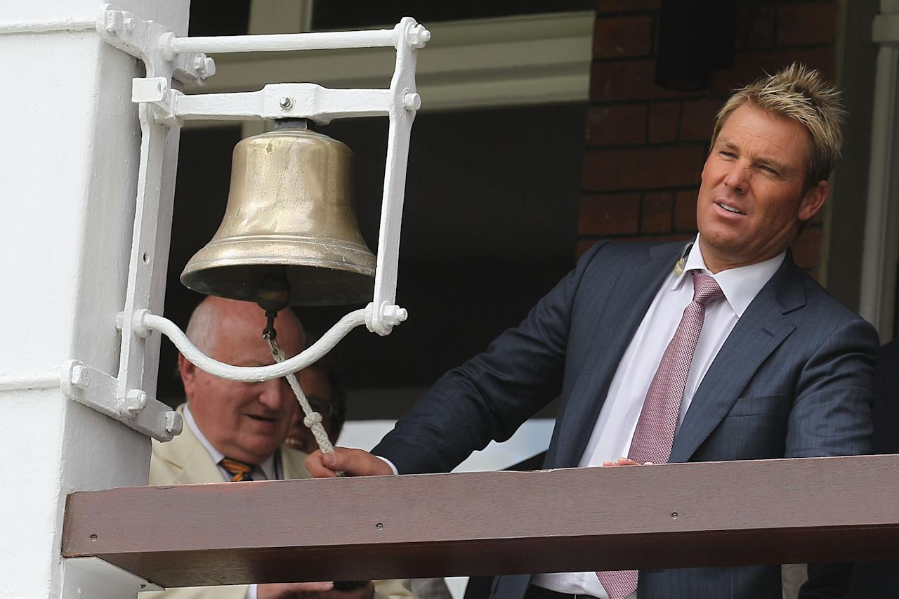 LONDON, ENGLAND - JULY 16:  Former Australian cricketer Shane Warne rings the five minute bell ahead of day four of the First Test between Pakistan and Australia at Lords on July 16, 2010 in London, England.  (Photo by Hamish Blair/Getty Images)