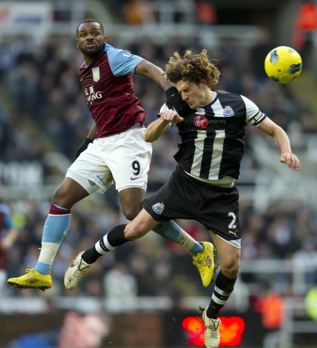 """Aston Villa's Darren Bent (L) vies with Newcastle United's Argentinian defender Fabricio Coloccini (R) during the English Premier League football match between Newcastle United and Aston Villa at St. James' Park in Newcastle on February 5, 2012. Newcastle won the game 2-1. AFP PHOTO / ADRIAN DENNIS RESTRICTED TO EDITORIAL USE. No use with unauthorized audio, video, data, fixture lists, club/league logos or """"live"""" services. Online in-match use limited to 45 images, no video emulation. No use in betting, games or single club/league/player publications"""