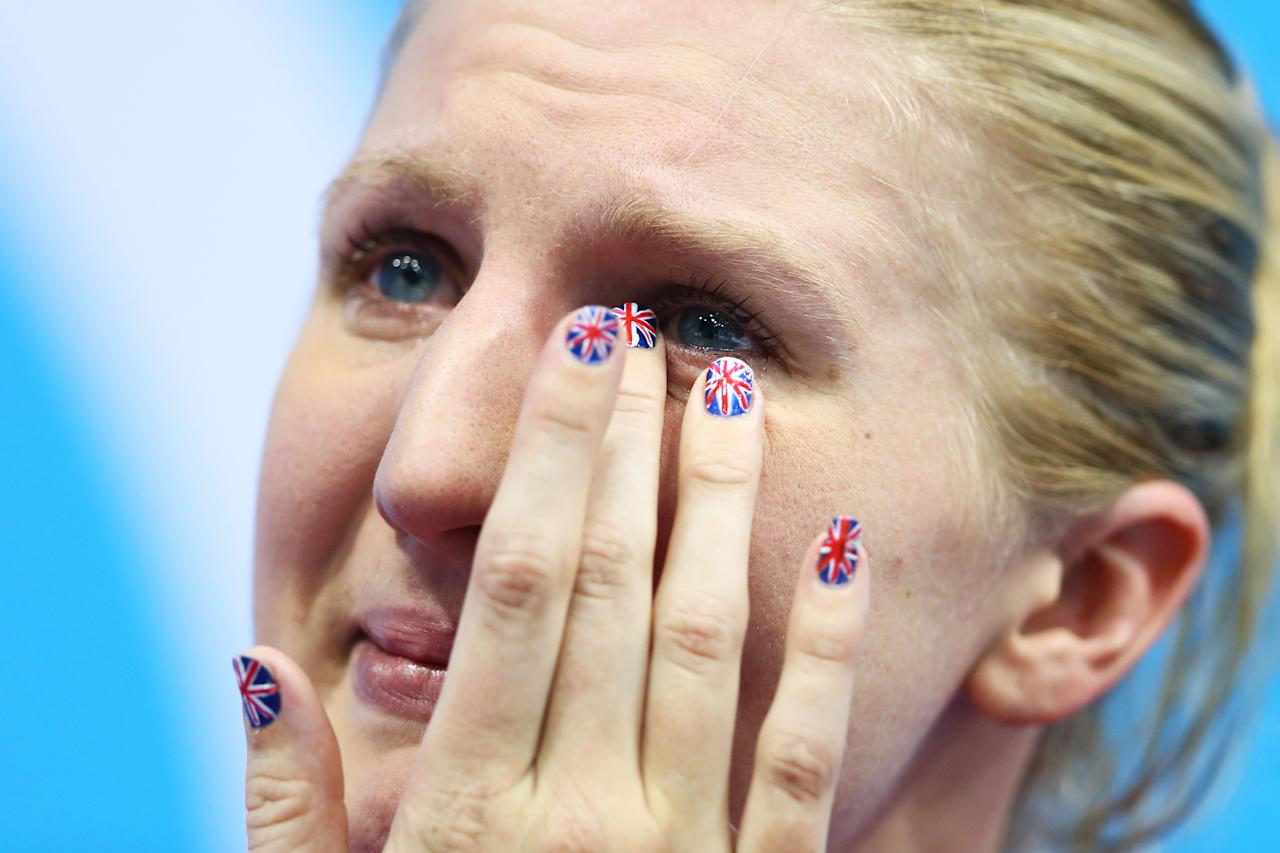 LONDON, ENGLAND - AUGUST 03:  Bronze medallist Rebecca Adlington shows her emotion on the podium during the medal ceremony for the Women's 800m Freestyle on Day 7 of the London 2012 Olympic Games at the Aquatics Centre on August 3, 2012 in London, England.  (Photo by Al Bello/Getty Images)