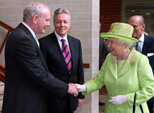 Britain's Queen Elizabeth II shakes hands with Northern Ireland Deputy First Minister Martin McGuinness