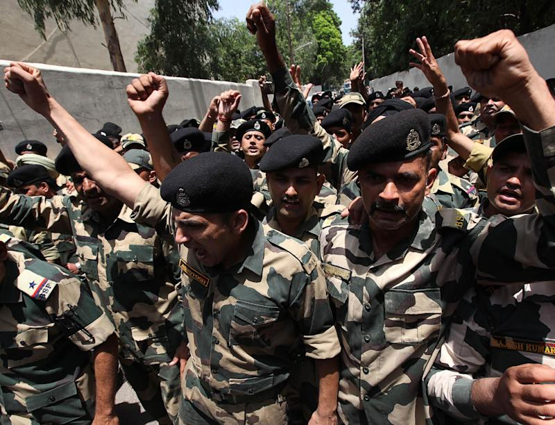 Indian border force soldiers shout anti-Pakistan and pro-India slogans during a wreath-laying ceremony in Jammu on Wednesday: AFP/Getty
