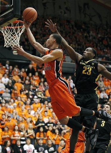 Oregon State guard Jared Cunningham, left, lays the ball up as Oregon forward Jeremy Jacob (23) defends in the first half of an NCAA college basketball game, Sunday, Feb. 26, 2012, in Corvallis, Ore. (AP Photo/Rick Bowmer)
