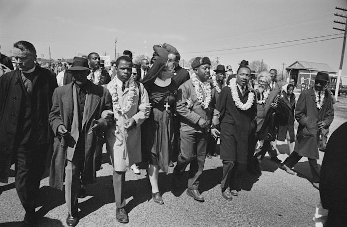 John Lewis seen third to the left with Dr Martin Luther King Jr. as they begin the Selma to Montgomery civil rights march from Brown's Chapel Church in Selma, Alabama, US, 21st March 1965. (Photo: William Lovelace via Getty Images)