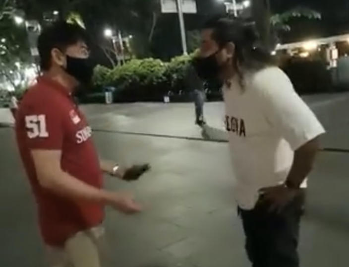 Tan seen in a viral video posted on Facebook on 6 June, 2021, confronting an inter-racial couple at Orchard Road. (SCREENCAP: Dave Park Ash/Facebook)