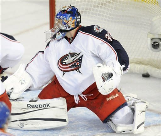 Edmonton Oilers' Ryan Nugent-Hopkins, not shown, scores on Columbus Blue Jackets goalie Curtis Sanford during the second period of an NHL hockey game Wednesday, March 14, 2012, in Edmonton, Alberta. (AP Photo/The Canadian Press, John Ulan)