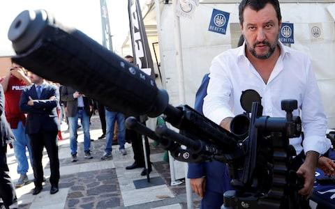 Italian Deputy Prime Minister and Interior Minister Matteo Salvini stands next to a sniper rifle during an event involving the state police SWAT team in Rome - Credit: Reuters