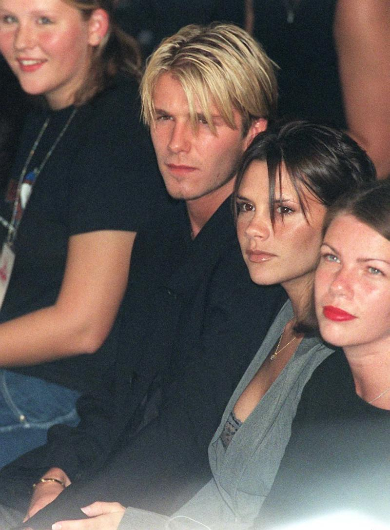 David Beckham and then girlfriend Victoria Adams watching the catwalk show of young British designer Antonio Berardi on the first day of London Fashion Week. He's taking it very seriously.