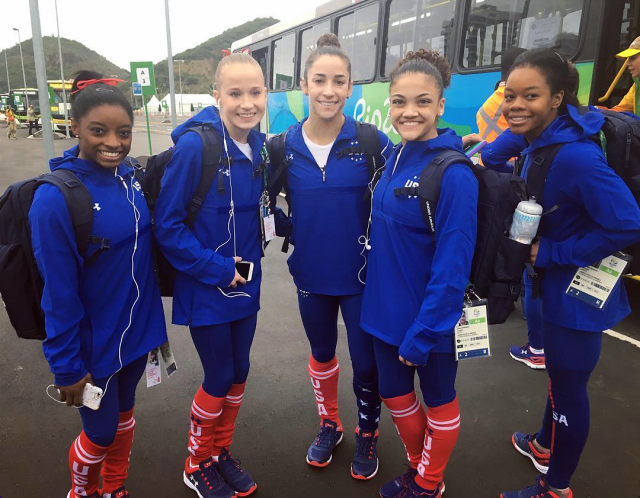 """<p>The team in Rio with their """"USA leg warmers on point."""" (alyraisman/Instagram) </p>"""