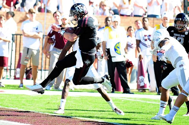 STARKVILLE, MS - NOVEMBER 03: Johnny Manziel #2 of the Texas A&M Aggies leaps into the endzone during a game against the Mississippi State Bulldogs at Wade Davis Stadium on November 3, 2012 in Starkville, Mississippi. (Photo by Stacy Revere/Getty Images)