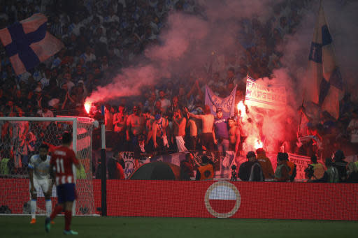 Marseille fans set off flares during the Europa League Final soccer match between Marseille and Atletico Madrid at the Stade de Lyon in Decines, outside Lyon, France, Wednesday, May 16, 2018. (AP Photo/Francois Mori)