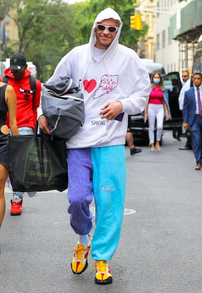 <p>Pete Davidson takes a walk through N.Y.C. with a smile, repping his home borough on Sept. 14.</p>