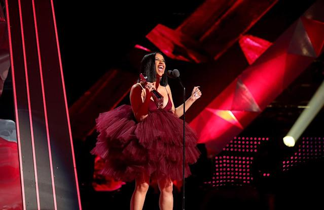 "<p>After picking up the Best New Artist award at the iHeartRadio Music Awards, the ""Bodak Yellow"" singer had plenty to say. She thanked her team, ""her man,"" rapper Offset, her fans, and then — in typical Cardi B fashion — she thanked her haters. ""They be downloading my stuff so they can hear it and talk crap about it. But it benefits me. Hahaha,"" she said. ""My album will be coming in April. Okay? Yes, sir. April. Stay tuned mother f***kers."" (Photo: Christopher Polk/Getty Images for iHeartMedia) </p>"
