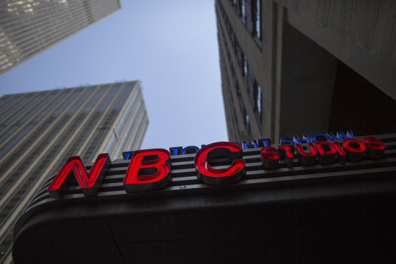 FILE - This Wednesday, May 10, 2017, file photo, shows the NBC logo at their television studios at Rockefeller Center in New York. On Wednesday, Oct. 11, 2017, President Donald Trump threatened NBC's broadcast licenses because he's not happy with how its news division has covered him. But experts say it's not likely his threats would lead to any action against the company. (AP Photo/Mary Altaffer, File)