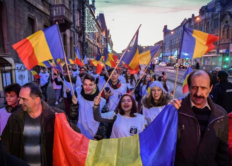 People march on the streets of Timisoara during a commemoration of the Romanian Revolution's first victims in the town 30 years ago