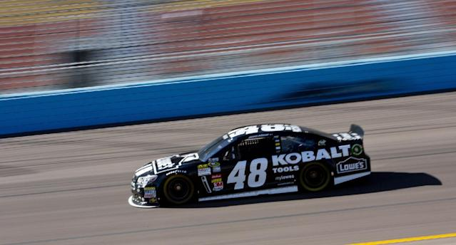Jimmie Johnson drives during practice for the NASCAR Sprint Cup Series auto race at Phoenix International Raceway on Friday, Nov. 8, 2013, in Avondale, Ariz. (AP Photo/The Arizona Republic, Patrick Breen)