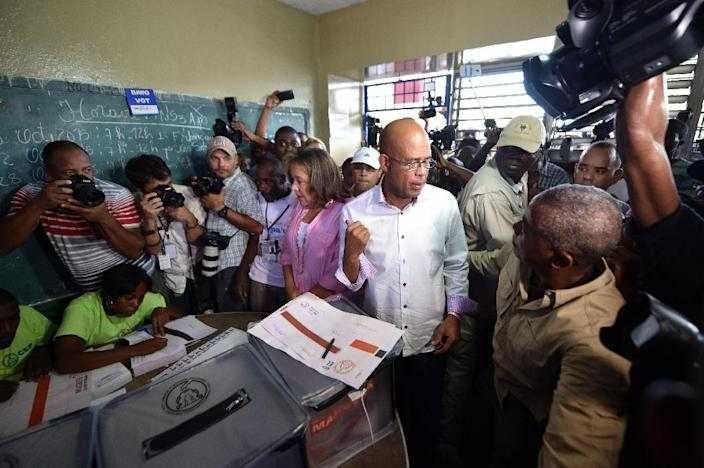 Haitian President Michel Martelly, in power since 2011, prepares to vote at the Lycee National de Petion Ville in Port-au-Prince on October 25, 2015 (AFP Photo/Hector Retamal)