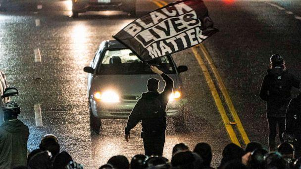 PHOTO: A protester waves a Black Lives Matter flag during racial justice protests, Nov. 3, 2020, in Seattle. (David Ryder/Getty Images, FILE)