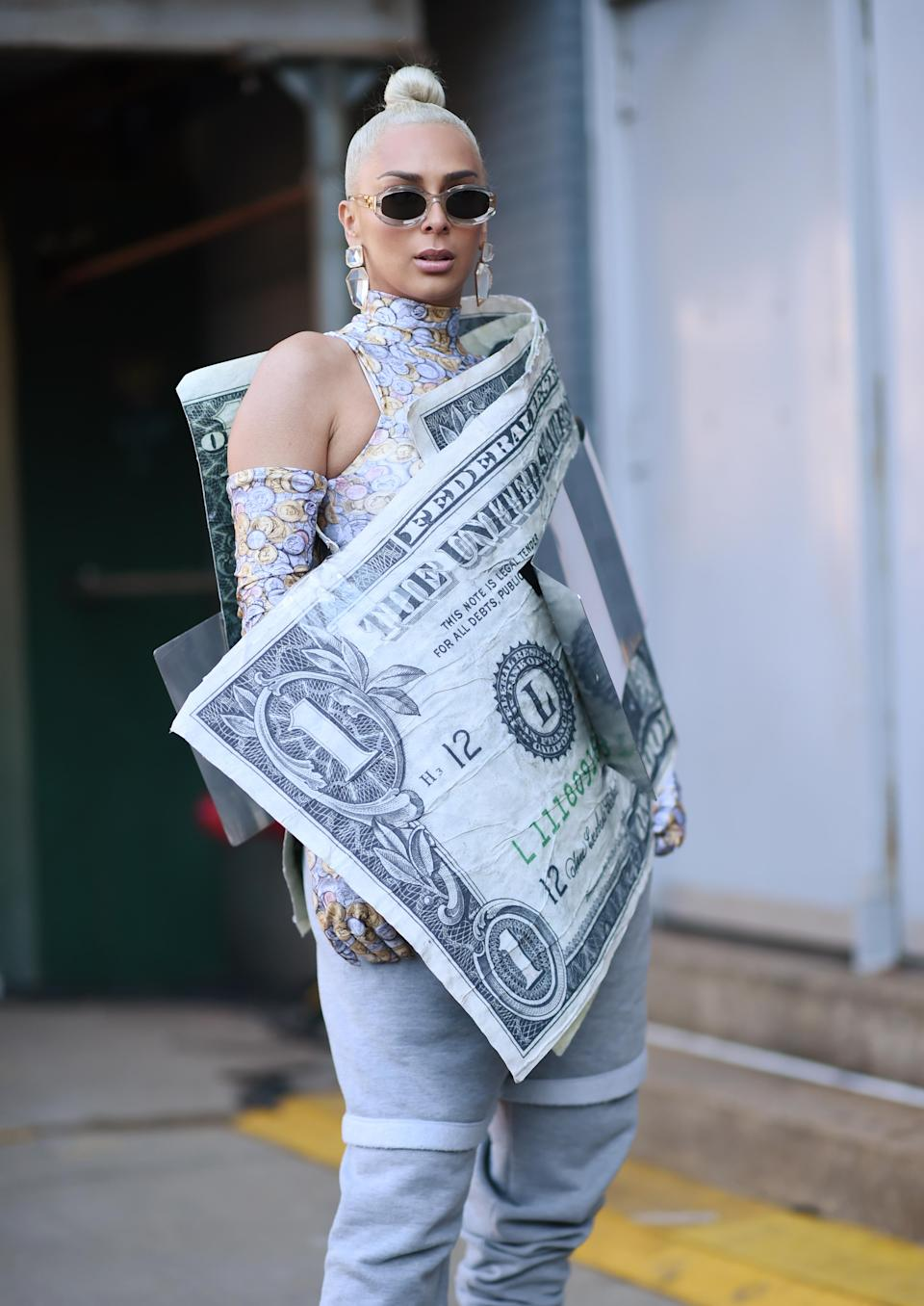 <p>A guest is seen wearing a money clip outfit outside the Taoray Wang show. <em>[Photo: Getty]</em> </p>