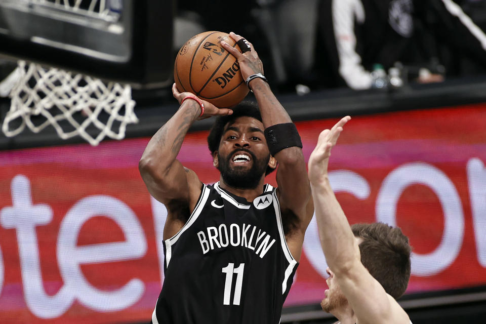 Brooklyn Nets guard Kyrie Irving (11) shoots against the Milwaukee Bucks during the second half of Game 1 of an NBA basketball second-round playoff series Saturday, June 5, 2021, in New York. (AP Photo/Adam Hunger)