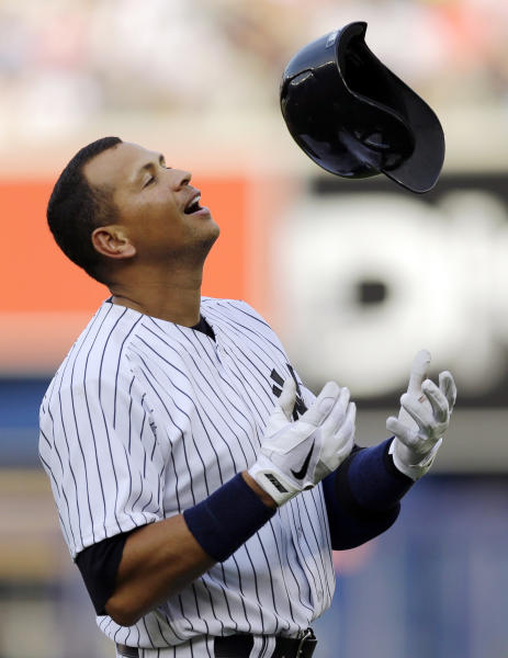 New York Yankees' Alex Rodriguez tosses his helmet after he was called out at first for the third out in the bottom of the fourth inning with two runners on-base in a baseball game against the Toronto Blue Jays at Yankee Stadium, Thursday, Aug. 22, 2013, in New York. (AP Photo/Kathy Willens)