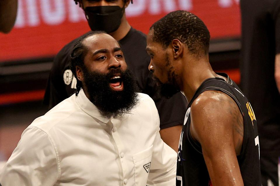 James Harden #13 of the Brooklyn Nets congratulates teammate Kevin Durant #7 after the third quarter against the Milwaukee Bucks during game two of the Eastern Conference second round series at Barclays Center on June 07, 2021 in the Brooklyn borough of New York City.
