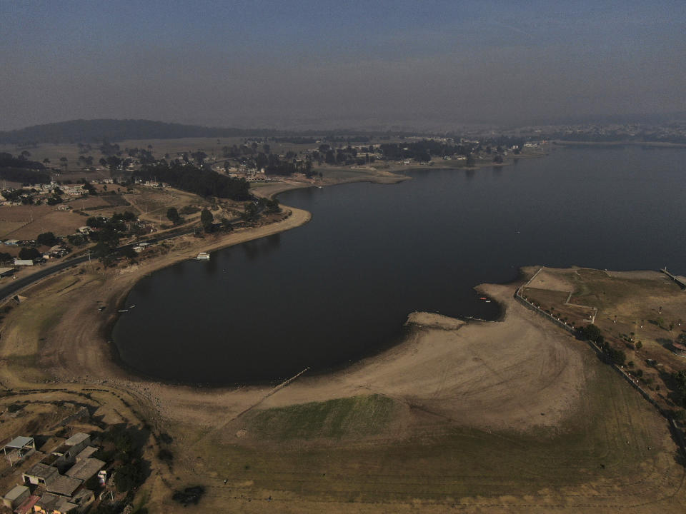 An aerial view of Villa Victoria Dam, the main water supply for Mexico City residents, on the outskirts of Toluca, Mexico Thursday, April 22, 2021. Drought conditions now cover 85% of Mexico, and in areas around Mexico City and Michoacán, the problem has gotten so bad that lakes and reservoirs are drying up. (AP Photo/Fernando Llano)