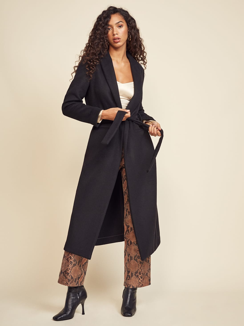"""<br><br><strong>Reformation</strong> Greenwich Coat, $, available at <a href=""""https://go.skimresources.com/?id=30283X879131&url=https%3A%2F%2Fwww.thereformation.com%2Fproducts%2Fgreenwich-coat"""" rel=""""nofollow noopener"""" target=""""_blank"""" data-ylk=""""slk:Reformation"""" class=""""link rapid-noclick-resp"""">Reformation</a>"""