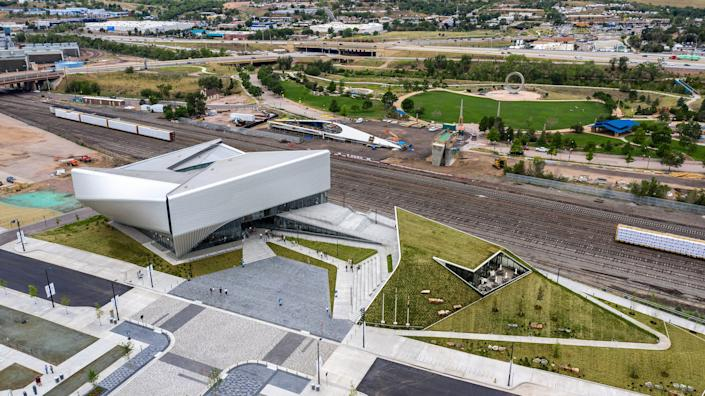 """<div class=""""caption""""> The new U.S. Olympic and Paralympic Museum is split into two structures on a slightly elevated campus—the museum and a building containing a cafe, theater, and event space. A natural amphitheater and plaza separate them. </div> <cite class=""""credit"""">Photo: Jason O' Rear</cite>"""