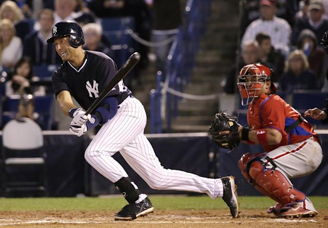 Philadelphia Phillies catcher Carlos Ruiz (51) watches as New York Yankees Derek Jeter grounds into a force out in a spring exhibition baseball game against the Philadelphia Phillies in Tampa, Fla., Tuesday, March 25, 2014. The Phillies defeated the Yankees 6-0. (AP Photo/Kathy Willens)