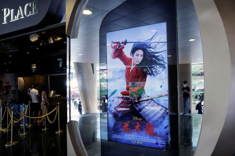 """Advertisement for Disney's war film """"Mulan"""" is pictured at a cinema in Hong Kong"""