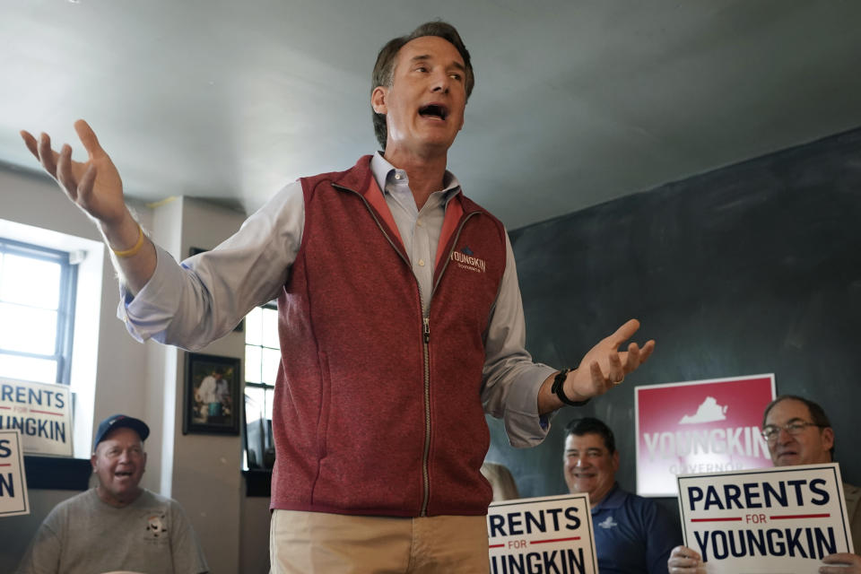 Virginia Republican gubernatorial candidate Glenn Youngkin gestures a he talks with supporters during a rally in Culpeper, Va., Wednesday, Oct. 13, 2021. Youngkin faces former Gov. Terry McAuliffe in the November election. (AP Photo/Steve Helber)