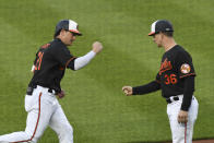 Baltimore Orioles' Austin Hays (21) is greeted by third base coach Tony Mansolino (36) after hitting a first-inning home run against New York Yankees starting pitcher Corey Kluber during a baseball game on Friday, May 14, 2021, in Baltimore. (AP Photo/Terrance Williams)
