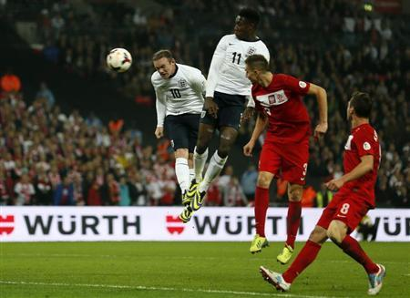 England's Wayne Rooney (L) heads the ball to score a goal during their 2014 World Cup qualifying soccer match against Poland at Wembley Stadium in London October 15, 2013. REUTERS/Stefan Wermuth