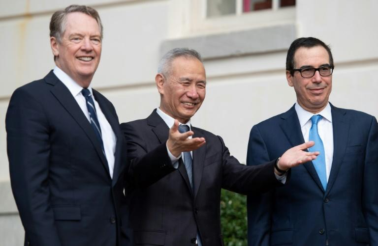 Chinese trade envoy Liu He is greeted by US Trade Representative Robert Lighthizer (L) and Treasury Secretary Steven Mnuchin (R)