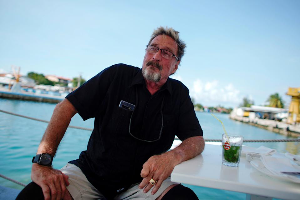 File: John McAfee, co-founder of McAfee Crypto Team and CEO of Luxcore and founder of McAfee Antivirus, speaks during an interview in Havana, Cuba, 4 July, 2019 (REUTERS)