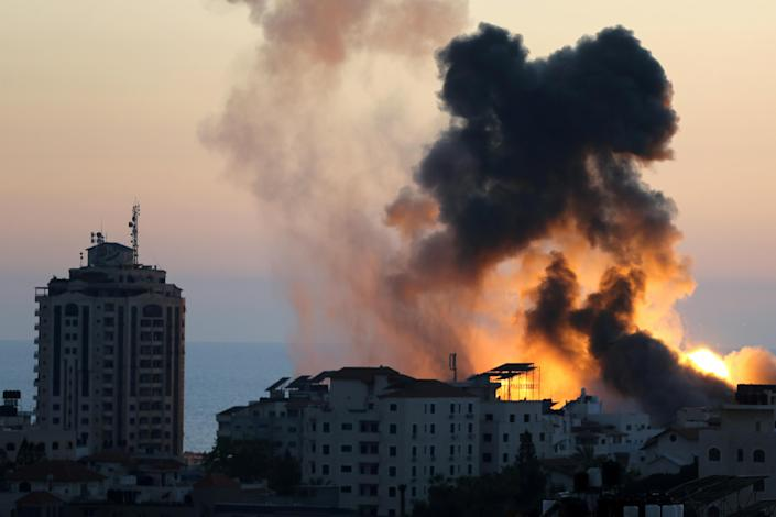 Smoke and flames rise during Israeli airstrikes as cross-border violence between the Israeli military and Palestinian militants continues in Gaza City on May 14, 2021. / Credit: Reuters/Ibraheem Abu Mustafa