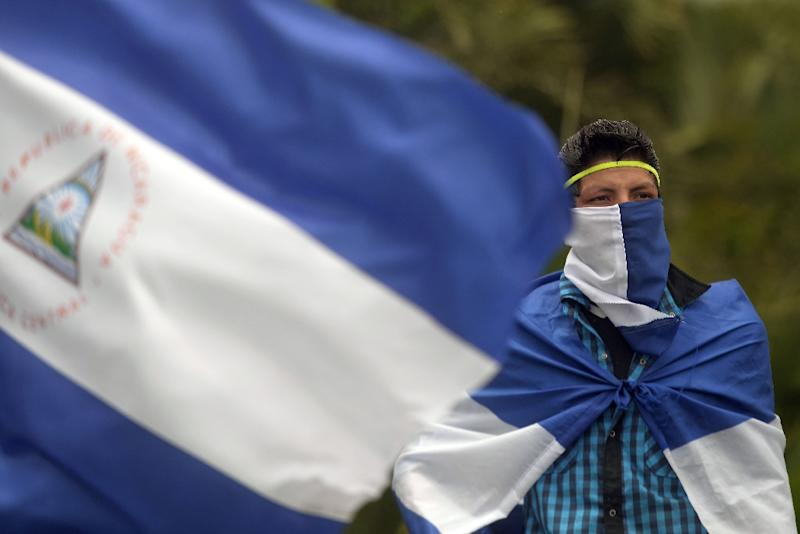 """Nicaraguan opposition protesters take part in a march called """"Masaya florecera"""" (Masaya will flourish), in support of the stronghold of anti-Ortega demonstrations in Managua on July 21, 2018 (AFP Photo/MARVIN RECINOS)"""