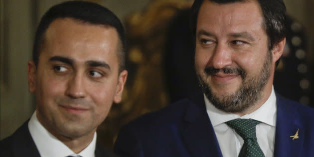 FILE - In this June 1, 2018 file photo, leader of the League party Matteo Salvini, right, stands by Luigi Di Maio, leader of the Five-Star movement, prior to the swearing-in ceremony for Italy's new government at Rome's Quirinale Presidential Palace. Five weeks after taking national office, opinion polls indicate that Salvini's anti-migrant, anti-European Union party has soared in popularity. (AP Photo/Gregorio Borgia, file)