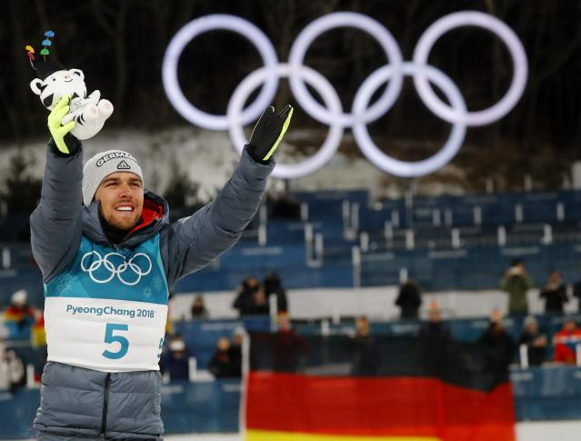 Nordic Combined Events - Pyeongchang 2018 Winter Olympics - Men's Individual 10 km Final - Alpensia Cross-Country Skiing Centre - Pyeongchang, South Korea - February 20, 2018 - Gold medalist, Johannes Rydzek of Germany celebrates during the victory ceremony. REUTERS/Kai Pfaffenbach