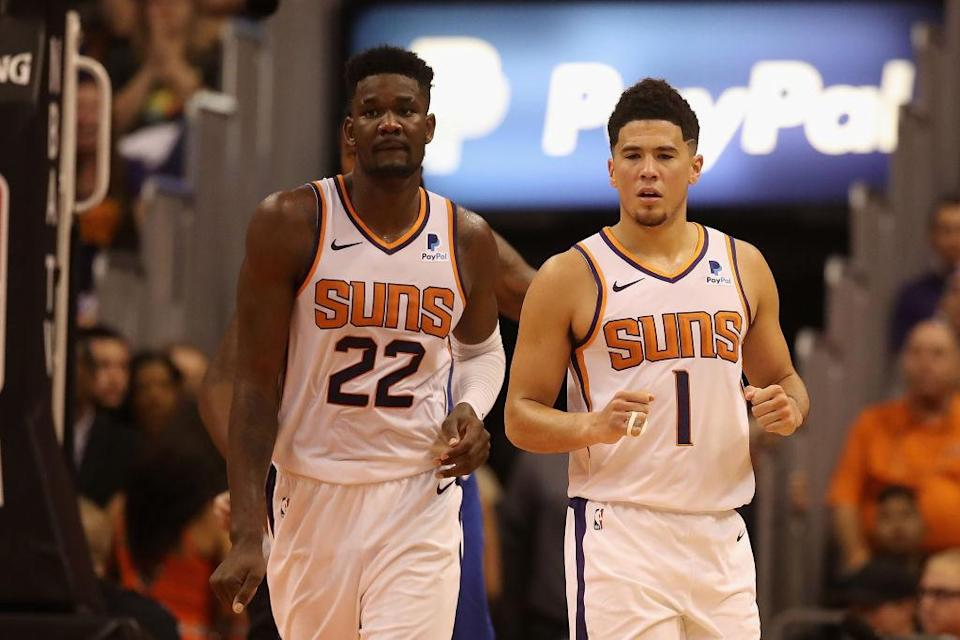 DeAndre Ayton and Devin Booker are frustrated by their Phoenix Suns' 2-8 start. (Getty Images)