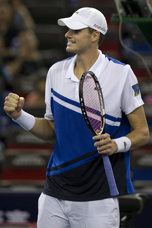 United States' John Isner celebrates after defeating Colombia's Santiago Giraldo during the first round at the Shanghai Masters Tennis tournament in the Qi Zhong Tennis Center in Shanghai, China on Monday, Oct. 7, 2013. Isner won 4-6, 7-5, 7-5. (AP Photo/Ng Han Guan)