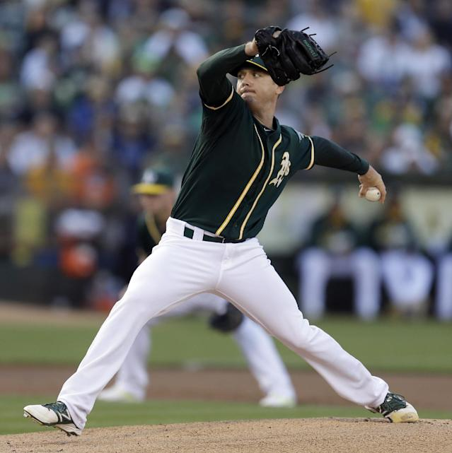 Oakland Athletics' Scott Kazmir works against the New York Yankees in the first inning of a baseball game on Saturday, June 14, 2014, in Oakland, Calif. (AP Photo/Ben Margot)
