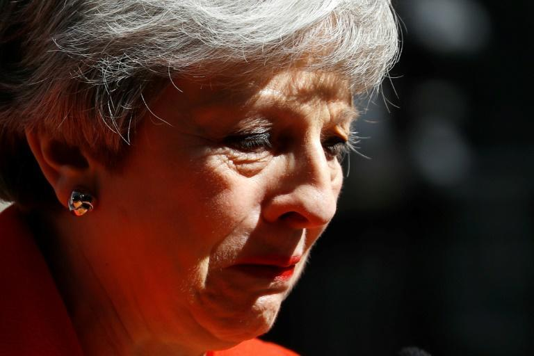Britain's Prime Minister Theresa May said she would step down as Conservative Party leader on June 7