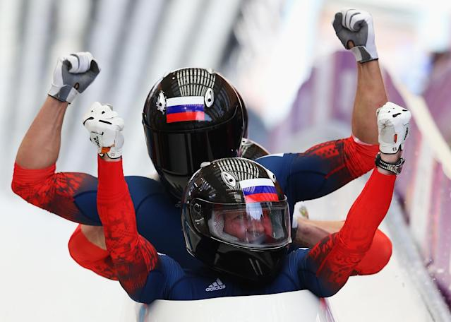 SOCHI, RUSSIA - FEBRUARY 23: Pilot Alexander Zubkov, Alexey Negodaylo, Dmitry Trunenkov and Alexey Voevoda of Russia team 1 celebrate winning the gold medal during the Men's Four-Man Bobsleigh on Day 16 of the Sochi 2014 Winter Olympics at Sliding Center Sanki on February 23, 2014 in Sochi, Russia. (Photo by Alex Livesey/Getty Images)