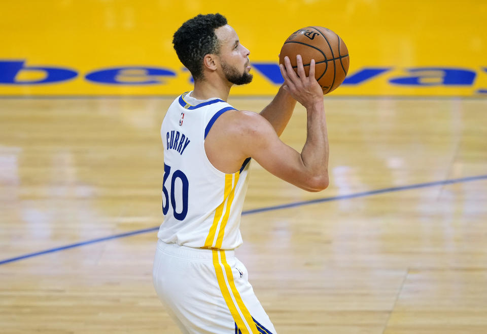 Steph Curry's shoes, which he created with the Bruce Lee Foundation, will be auctioned off to support the families of the victims of the Atlanta spa shootings. (Photo by Thearon W. Henderson/Getty Images)