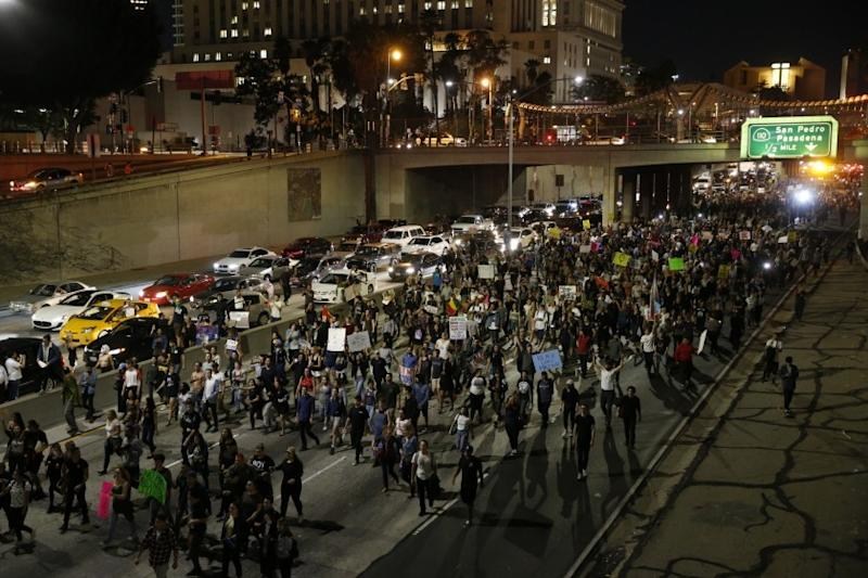 Anti-Trump protesters march on the 101 Freeway near downtown Los Angeles on Nov. 9.