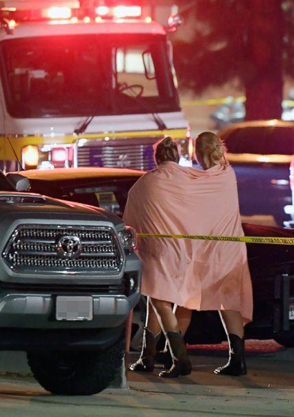 PHOTO: People walk away from the scene, Nov. 8, 2018, in Thousand Oaks, Calif., where a gunman opened fire Wednesday inside a country dance bar crowded with hundreds of people on 'college night.' (Mark J. Terrill/AP)