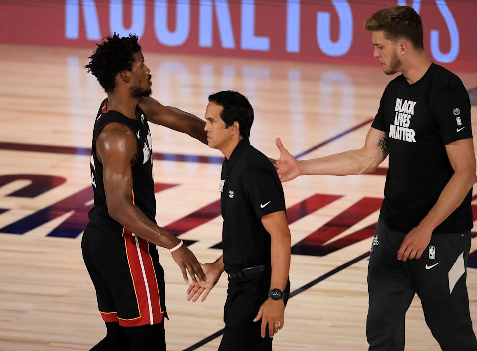 Jimmy Butler #22 of the Miami Heat shakes hands with Erik Spoelstra of the Miami Heat after their win against the Milwaukee Bucks.