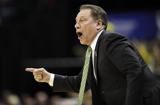 Michigan State head coach Tom Izzo directs his team in the first half of an NCAA college basketball game against Michigan in the championship of the Big Ten Conference tournament on Sunday, March 16, 2014, in Indianapolis. (AP Photo/Kiichiro Sato)
