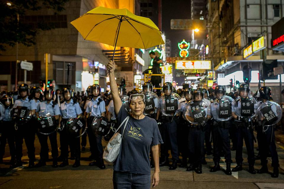 "<div class=""inline-image__caption""><p>A pro-democracy activist holds a yellow umbrella in front of a police line on a street in Mongkok district on November 25, 2014 in Hong Kong. The Mong Kok protest site is scheduled for clearance by bailiffs this week after Hong Kong's high court authorized police to arrest protesters who obstruct bailiffs on the three interim restraining orders.</p></div> <div class=""inline-image__credit"">Chris McGrath/Getty</div>"